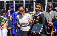 Nompumelelo Nobiva graduating from Johnson C. Smith University, poses with Oprah Winfrey. Picture: Supplied.