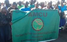 Amcu members march during one year anniversary at Lonmin's Marikana mine where 34 striking platinum workers were shot dead by police on 16 August 2012. Picture: Gia Nicolaides/EWN