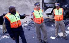 FILE: KwaZulu-Natal MEC for Transport, Community Safety and Liaison Mr Mxolisi Kaunda with Road Traffic Inspectorate (RTI) officials inspecting the area where 18 trucks were set alight at Mooi River Toll Plaza on the N3. Picture: @GovernmentZA/Twitter