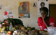 A Zimbabwean woman looks on by her vegetable's stand in Seke Rural village 45Km south of Harare. Picture: AFP.