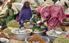 Women sell goods at a market in Niamey, Niger on June 12, 2016. Picture: AFP