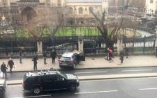 A picture obtained from the Twitter account of James West shows the car, which Khalid Masood ploughed through a crowd of people, on the sidewalk in front of the Palace of Westminster which houses the Houses of Parliament in central London. Picture: AFP/James West.