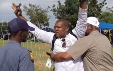 Journalist Sam Mkokeli manhandled by security at Nasrec. Picture: ShoeShoe Qhu/Kaya FM