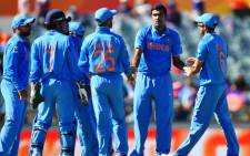 FILE: India's Ravichandran Ashwin (2nd-R) celebrates with teammates after taking the wicket of United Arab Emirates batsman K. Karate during the 2015 Cricket World Cup Pool B match between the UAE and India. Picture: AFP.