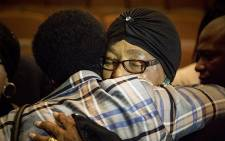 Struggle stalwart Winnie Madikizela-Mandela hugs a woman after a memorial briefing for anti-apartheid activist Ahmed Kathrada on 28 March 2017. Picture: Reinart Toerien/EWN