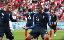 France's Kylian Mbappe (R) celebrates scoring their first goal with Antoine Griezmann (L). Picture: @FIFAWorldCup/Twitter.