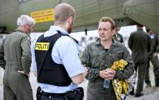 "Peter Madsen (R), builder and captain of the private submarine ""UC3 Nautilus"" talks to a police officer in Dragoer Harbor south of Copenhagen on Friday 11 August 2017 following a major rescue operation after the submarine sank in the sea outside Copenhagen Harbor. A swedish woman supposed to be on board the submarine is still missing. Picture: AFP."