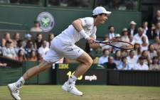 Britain's Andy Murray chases down a return against Italy's Fabio Fognini during their men's singles third round match on the fifth day of the 2017 Wimbledon Championships at The All England Lawn Tennis Club in Wimbledon on 7 July 2017. Picture: AFP.
