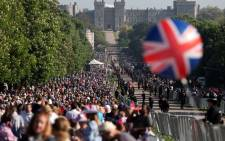 Well-wishers line the Long Walk leading to Windsor Castle ahead of the wedding and carriage procession of Britain's Prince Harry and Meghan Markle in Windsor on 19 May 2018. Picture: AFP.