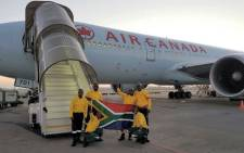 Over 300 South African firefighters board a Boeing 777 to Canada to assist Fort McMurray in battling raging wild fires, which have been blazing for over a month. 29 May 2016. Picture: Supplied.