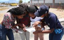 Pupils in Cape Town check their 2017 matric results. Picture: Bertram Malgas/EWN