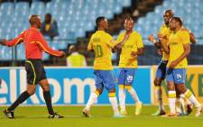 FILE: Mamelodi Sundowns players congratulate their team mate, Surprise Moriri after scoring in the PSL match against Bloemfontein Celtic on 9 April 2014. Picture: Facebook.