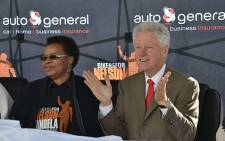 """Former US President Bill Clinton enjoys a traditional dance performace at the No Moscow Primary School in Qunu where he opened a new library on 17 July 2012. Picture: Aletta Gardner/EWN"