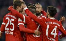 Bayern Munich's German forward Thomas Mueller (L) is congratulated by teammates after he scored the team's 100th goal during the German first division Bundesliga football match Bayern Munich vs Werder Bremen in Munich, southern Germany, on 21 January 2018. Bayern won 4-2. Picture: AFP.