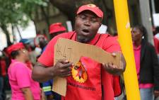 A member of metalworkers union Numsa holds up a cardboard gun  on October 2015. Picture: Reinart Toerien/EWN