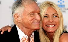 In happier times: Playboy founder Hugh Hefner with his former fiance Crystal Harris. Picture: AFP