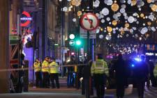 Police set up a cordon outside Oxford Circus underground station as they respond to an incident in central London on 24 November 2017. Picture: AFP