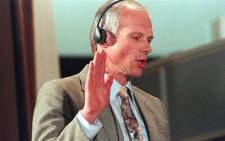 FILE: Janusz Walus takes an oath on 20 August 1997 at an amnesty hearing for the 1993 murder of SACP leader Chris Hani. Picture: AFP.