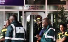 Paramedics work at Charlotte Maxeke Hospital's main entrance where a roof collapsed on 2 March 2017. Picture: Christa Eybers/EWN
