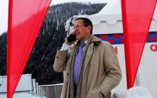 CNN's Richard Quest on the phone to 567 CapeTalk/Talk Radio 702's Bruce Whitfeidl from Davos, 24 January 2014. Picture: @cnnpruk via Twitter.