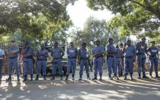 FILE: Police officers guard the Hoerskool Overvaal on 17 January 2018 following protests over an admissions row between the school and the Gauteng Education Department. Picture: Ihsaan Haffejee/EWN