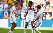 FILE: Germany's Thomas Muller celebrates with his team mates after scoring his third goal against Portugal during the opening match in their group of the 2014 Fifa World Cup in Brazil on 16 June 2014. Picture: Fifa.com.