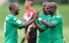 Veteran AmaZulu striker Siyabonga Nomvete (left) celebrates with his teammates. Picture: @AmazuluFootball/Twitter