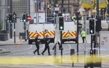 FILE: Armed police patrol near Manchester Arena following a deadly terror attack in Manchester, north-west England on 23 May 2017. Picture: AFP