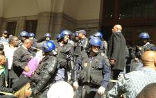 Police keep an eye on ANCYL protesters outside the Western Cape legislature on 27 August 2012. Picture: Regan Thaw/EWN