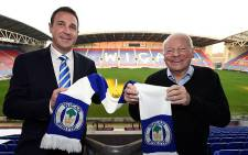 Wigan Athletic owner Dave Whelan (R) welcomes new manager Malky Mackay to the club on 19 November 2014. Picture: Official Wigan Athletic Facebook page.