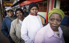 FILE: Pensioners queue outside of a supermarket in Mitchells Plain on the 1st of the month to collect their SASSA grants. Picture: Thomas Holder/EWN.