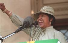 FILE: Anti-apartheid campaigner Winnie Madikizela-Mandela forms the ANC clenched fist and salutes supporters during a rally in Johannesburg on 16 June 1996 to mark the 20th anniversary of the Soweto student uprising.  Picture: AFP.