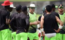 Zimbabwe cricket coach Heath Streak (C) chats with cricketers during a practice session at Galle International Cricket Stadium in Galle on 28 June 2017. Picture: AFP