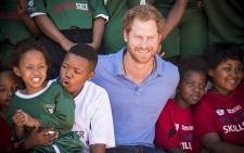 Prince Harry laughs with children from Grassroots Soccer at the Khayelitsha Football for Hope sports centre. Picture: Thomas Holder/EWN