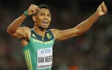 South Africa's Wayde van Niekerk celebrates after winning second place in the final of the men's 200m athletics event at the 2017 IAAF World Championships at the London Stadium in London on 10 August 2017. Picture: AFP.