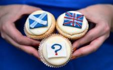 Referendum cupcakes featuring a Scottish Saltire, (L) a Union flag (R) and a question mark (Below) symbolising the 'undecided voter' are pictured at a bakery in Edinburgh, Scotland, on 16 September 2014. Picture: AFP.