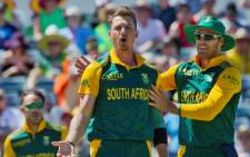 South African bowler Dale Steyn (centre) and captain AB de Villiers (right) react after taking the wicket of Australian batsman Nathan Coulter-Nile during the second one-day international (ODI) cricket match of the series between Australia and South Africa in Perth on November 16, 2014. Picture: AFP