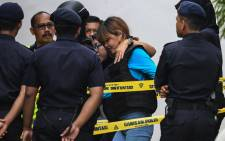 Vietnamese national Doan Thi Huong is escorted by Malaysian police after a court appearance with Indonesian national Siti Aisyah (not pictured) at the magistrates' court in Sepang on 13 April, 2017, for their alleged role in the assassination of Kim Jong-Nam, the half-brother of North Korean leader Kim Jong-Un. Picture: AFP.
