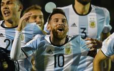 Argentina's Lionel Messi celebrates after defeating Ecuador and qualifying to the 2018 World Cup football tournament in Quito, on 10 October 2017. Picture: AFP.