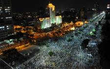 People march in downtown Rio de Janeiro on 20 June 2013 during a protest called the 'Tropical Spring' against corruption and price hikes. Picture: AFP.