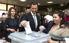 A handout picture released by the official Syrian Arab News Agency on 13 April, 2016 shows Syrian President Bashar al-Assad and his wife Asma (left) casting their votes at a polling station in Damascus during the parliamentary elections. Picture: AFP.