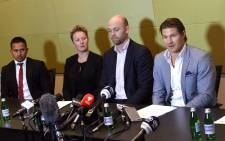FILE: This file photo taken on 2 July 2017 shows cricket players Usman Khawaja (L), Clea Smith (2/L), Shane Watson (R) and Australian Cricketers' Association (ACA) chief executive Alistair Nicholson (2/R) attending a press conference in Sydney on 2 July 2017. Picture:  AFP.