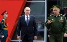 Russian President Vladimir Putin and Defence Minister Sergei Shoigu arrive for the opening of the Army-2015 international military forum in Kubinka, outside Moscow, on 16 June 2015. Picture: AFP.