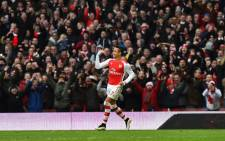 Arsenal's Chilean striker Alexis Sanchez celebrates after scoring their second goal during the English Premier League football match between Arsenal and Stoke City at the Emirates Stadium in London on 11 January, 2015. Arsenal won the game 3-0. Picture: AFP