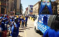 Democratic Alliance members chant outside the High Court in Pretoria as they wait for the so-called Zuma spy tapes to be handed to the party on 4 September, 2014. Picture: Picture: Vumani Mkhize/EWN.
