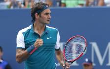 Roger Federer of Switzerland celebrates after defeating Leonardo Mayer of Argentina during their 2015 US Open Men's Singles round 1 match at the USTA Billie Jean King National Tennis Center 1 September, 2015 in New York. Picture: AFP.