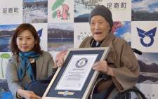 FILE: Masazo Nonaka of Japan (R), aged 112, receives a certificate for the Guinness World Records' oldest male person living title from Erika Ogawa (L), vice president of Guinness World Records Japan, in Ashoro. Picture: AFP