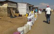 Residents wait for fresh water. Picture: EWN