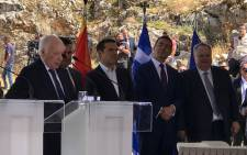 Greek and Macedonian leaders, along with UNSG Personal Envoy Matthew Nimetz, sign an agreement resolving the name issue in the presence at Lake Prespa on 17 June 2018. Picture: @GreeceMFA/Twitter