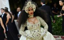 FILE: Cardi B arrives for the 2018 Met Gala in a custom Moschino outfit and bedazzled headpiece. Picture: AFP.